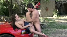 Well-endowed bitch with dark hair and cool big tits is rammed outdoors