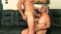 Chunky older woman Kokai gives a young stud a sloppy blowjob