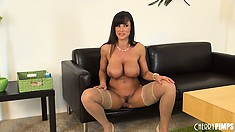 Stunning MILF with well-toned abs and massive titties poses naked
