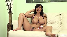 Lisa Ann shows off her huge tits and plays with her wet pussy