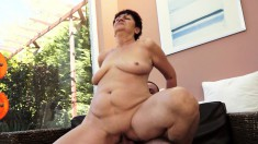 Short haired mature works her lips and her twat on a young guy's dick