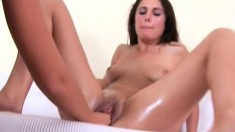 Malina tries out a baseball bat before she gets her hole fisted
