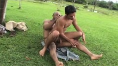 Muscled black slave gives a hot white guy a deep anal fucking outside