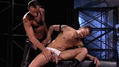 Sexy gay hunk in leather loves to take a fist up his needy anal hole