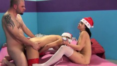 Horny nymphets Carmen Caliente and Kimmy Lee go wild in a Christmas threesome