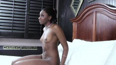 Slender black girl has a big white stick providing infinite pleasure