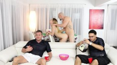 Hung stud fucks a horny blonde while two guys watch the football game