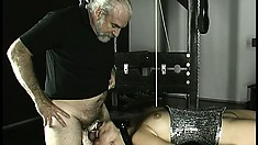 She goes down on his tied up pecker and gives some nice head