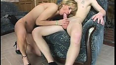 Naughty blonde mom bangs one of her son's lucky young friends