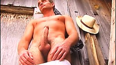 Ripped farmer with a big hard member jerks off behind a barn