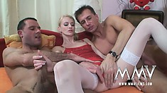 Skinny little blonde works hard to please two men with her mouth and bald cunt