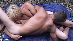Pale blonde twink takes his best buddy balls deep in the woods