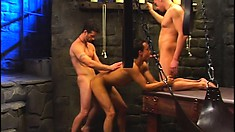 Dungeon fun where a stud slave gets tortured and two cocks in his ass