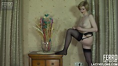 Slim blonde in black stockings Alina reveals her sexy tits and perky ass