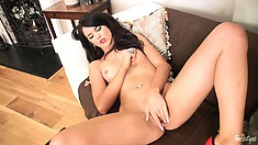 This brunette has a sexy pierced belly and an incredibly wet cunt