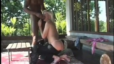Desirable blonde with tiny tits Nicole takes a black shaft up her ass