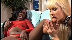 Blonde and black lesbians are joined by a hung guy for a hot threesome