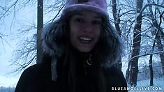 Fine european babe takes a walk through the woods during winter