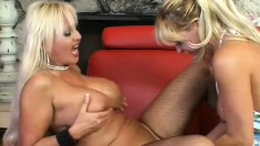 Mature blonde lesbians having lots of fun with sex toys on the couch