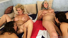 An orgy of pussy with old and young lesbians munching the rug