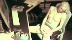 Hidden camera captures a pale blonde hottie fiddling with herself