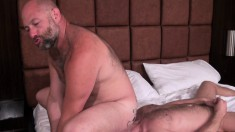 Sailor Blue and Freddy Wolf satisfy their sexual desires on the bed