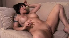 Busty brunette June Summers and her lover use toy and tongue on their cunts