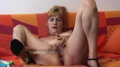 Busty Iva gets naked to finger her clit and toy fuck her twat