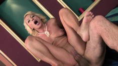 Busty blonde mom with a fabulous ass takes on a young stud's big dick