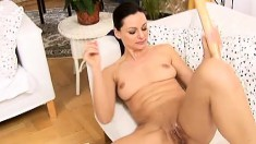 Dark-haired sex goddess uses her hands to make this chick cum