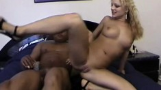Tanned blonde broad spreads her legs to let in a massive black dick