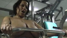 Gorgeous brunette Aneta puts her massive hooters on display in the gym