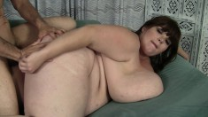 Fat girl with incredibly large tits can suck on them while fucking