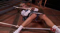 Blonde schoolgirl with a nice ass is all tied up on the floor