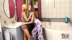 Little teenies love candy and also sharing some hot lesbian kisses in the bathroom