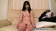 Yuko takes her clothes off to reveal a perfect pair of tits and yummy pussy