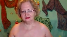 Beautiful And Mature Mom With Big Boobs Fucks A Dildo