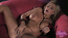 With her fingers and a sex toy the busty blonde with a hot ass drills her tight holes