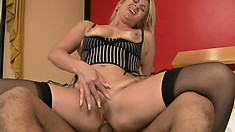 Blonde Simira in black stockings gets her pussy eaten and fucked