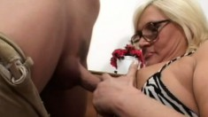A spectacled blonde MILF with massive melons gets a hard dicking